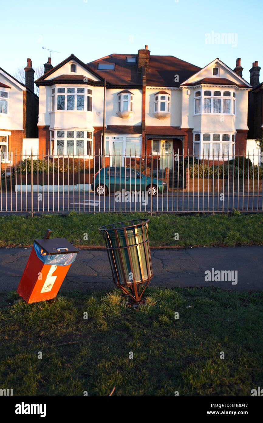 Bent rubbish bins in front of Edwardian-era semi-detached houses on Ruskin Park, Denmark Hill SE24 - Stock Image