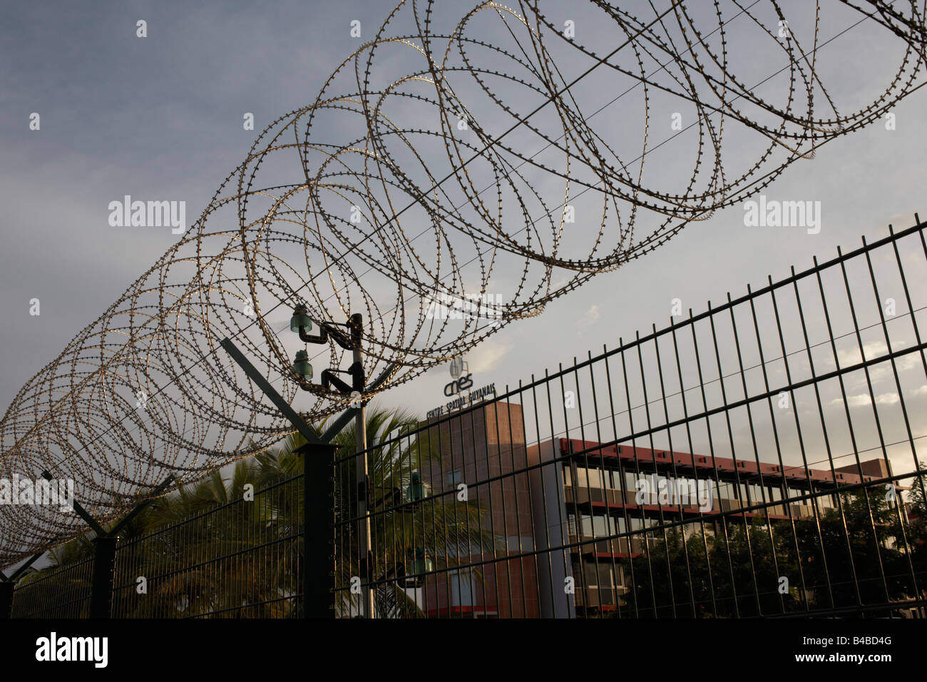 Secure razor wire and fencing keeps trespassers out from the European Space Agency's Neptune buildings in French - Stock Image