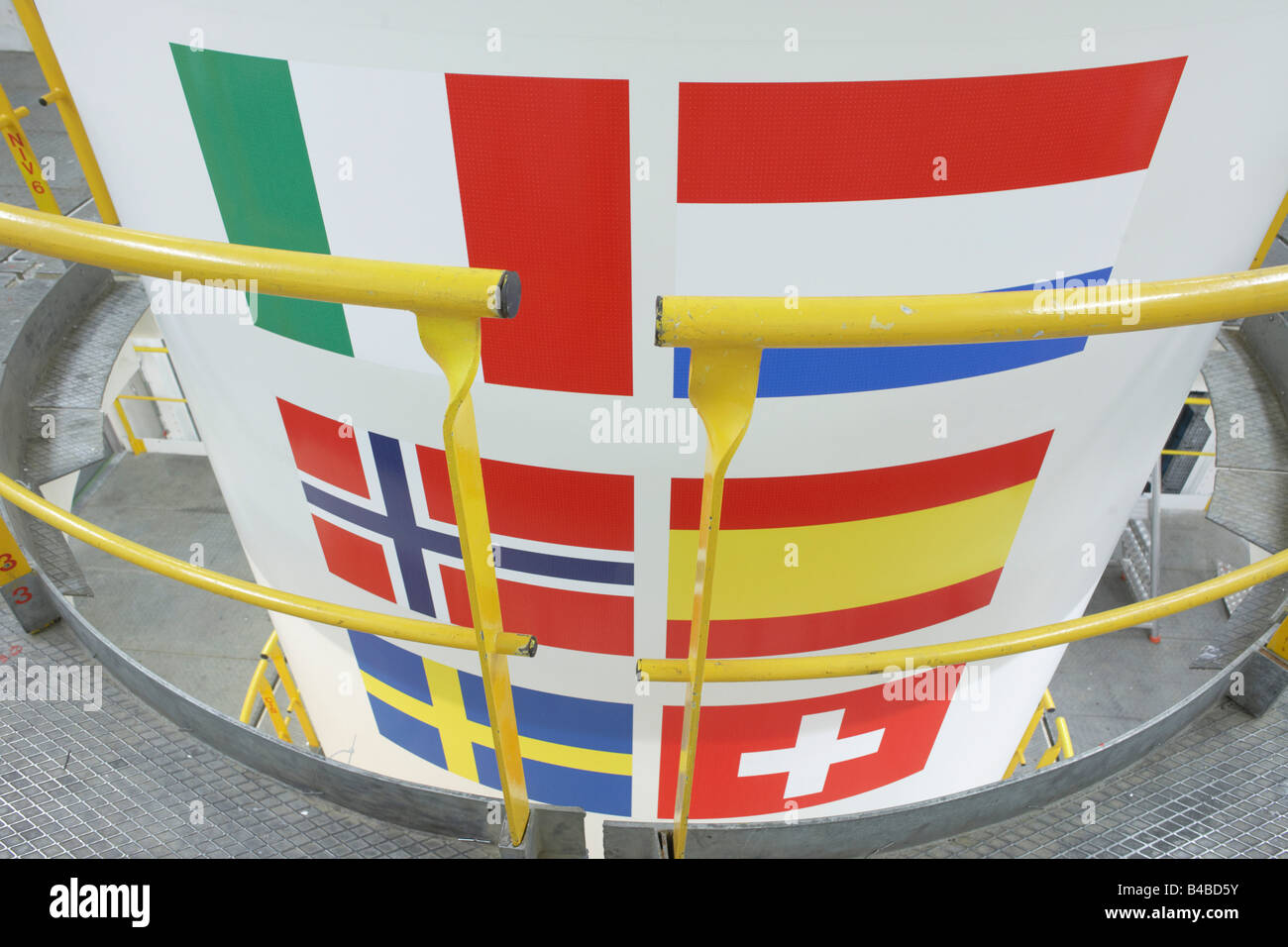 Member country flags, Ariane 5 rocket booster in Europropulsion's Booster Integration Building, European Space - Stock Image