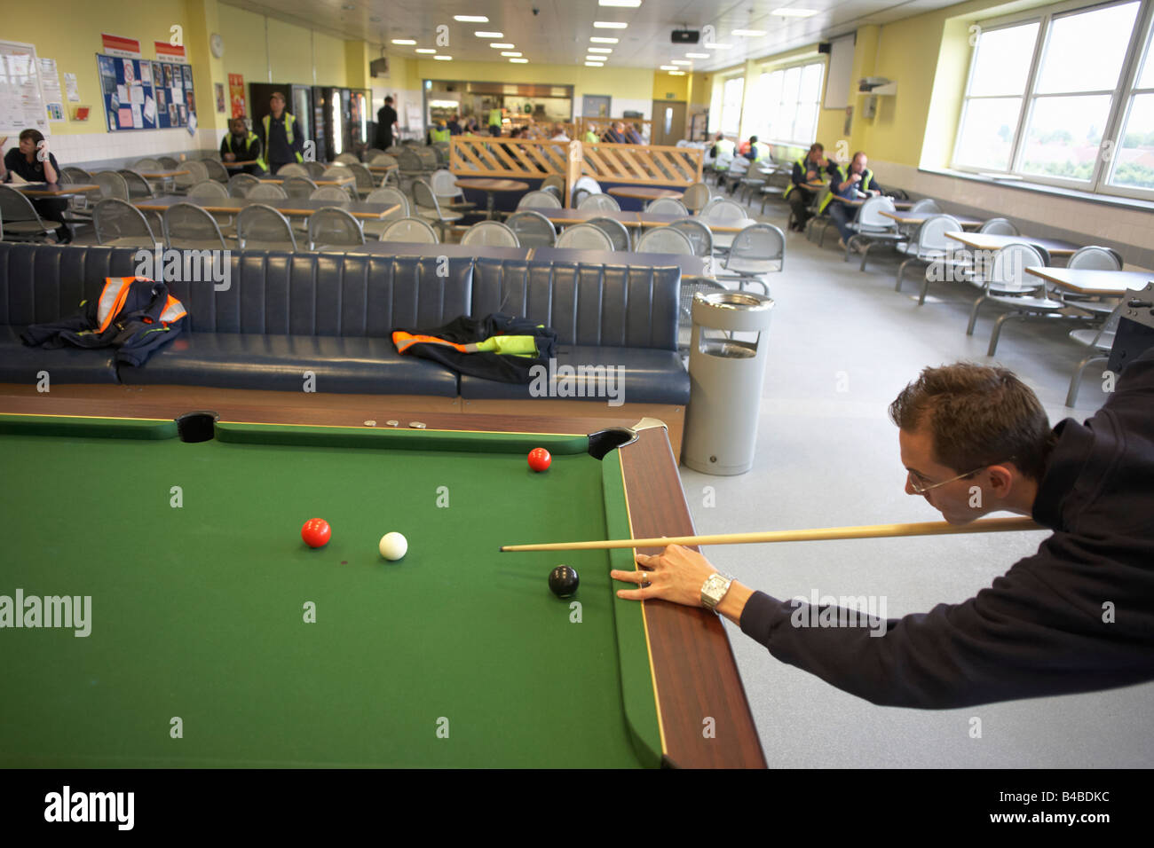 An employee of sainsbury 39 s plays pool during his lunch break in the stock photo 19921200 alamy for Waltham abbey swimming pool times