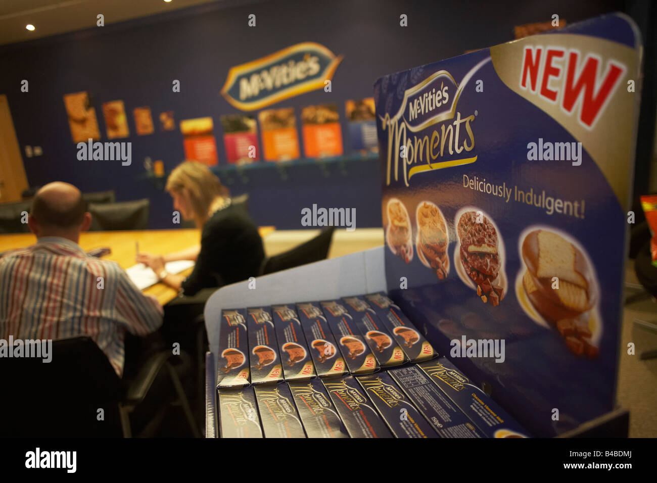 A creative biscuit-making team exchange new marketing ideas in a private room at the United Biscuits Group offices, - Stock Image