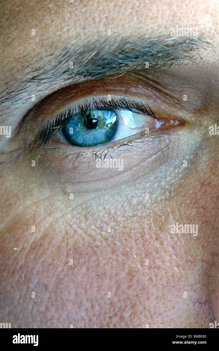 Closeup Portrait Of A Baby Boomer Man With Piercing Blue Eyes Using Stock Photo Alamy