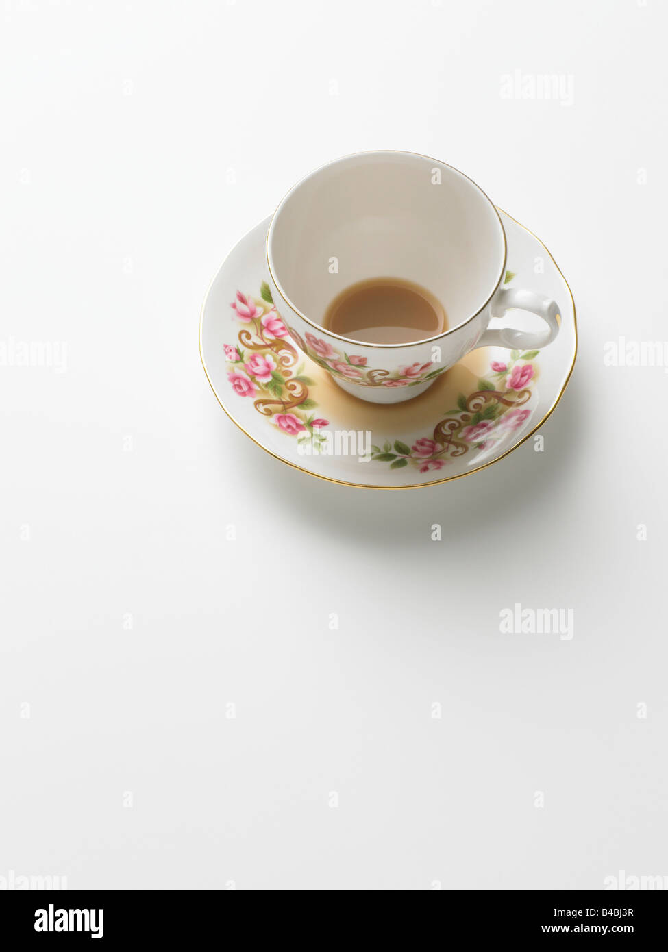 Floral tea cup on plain background - Stock Image