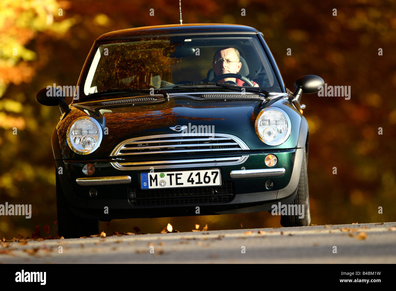 Car, Mini One D, model year 2001-, dark green, Miniapprox.s, Limousine, FGHDS, driving, frontal view, side view, - Stock Image