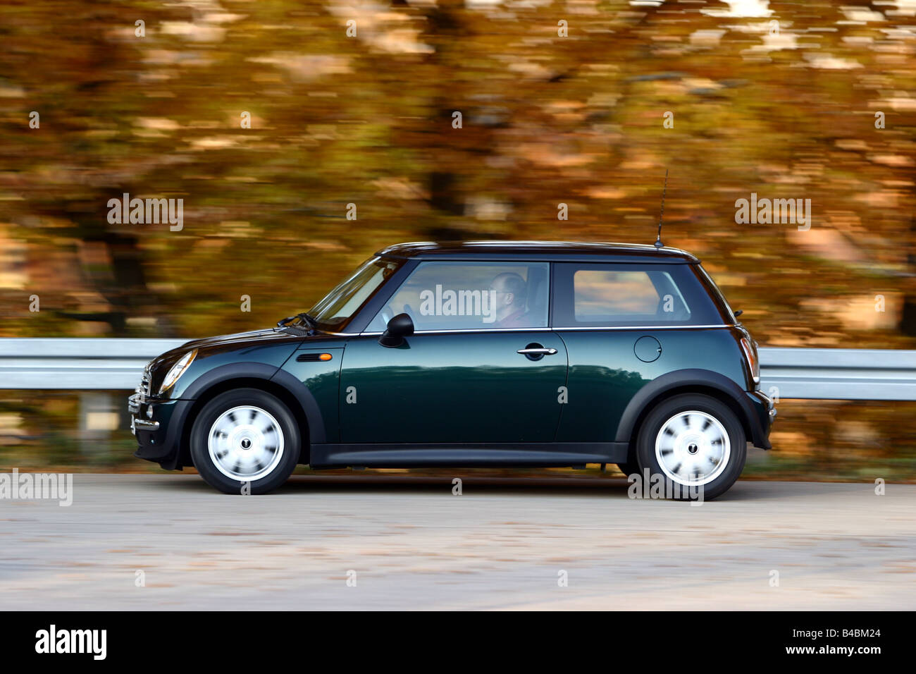 Car, Mini One D, model year 2001-, dark green, Miniapprox.s, Limousine, FGHDS, driving, side view, country road - Stock Image