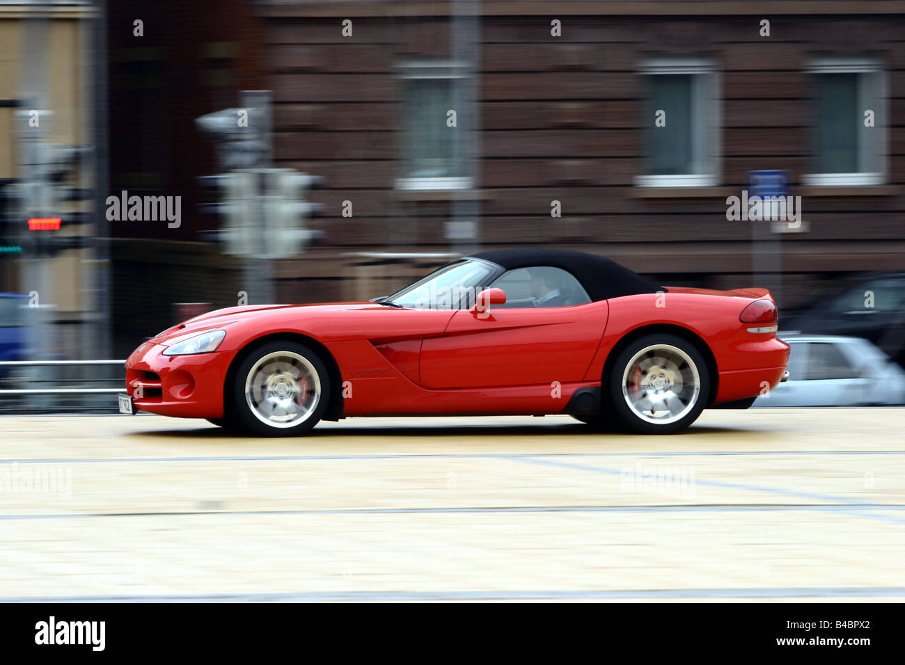 Car, Dodge Viper SRT-10, Convertible, model year 2003-, red, FGHDS, closed top, driving, side view, City - Stock Image