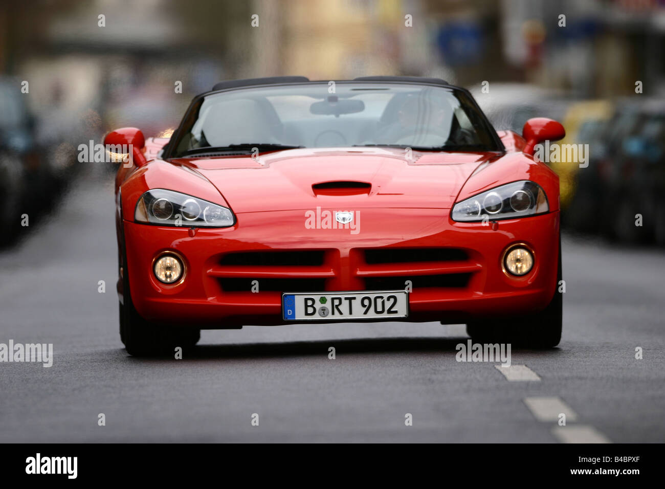 Car, Dodge Viper SRT-10, Convertible, model year 2003-, red, FGHDS, open top, driving, frontal view, City - Stock Image