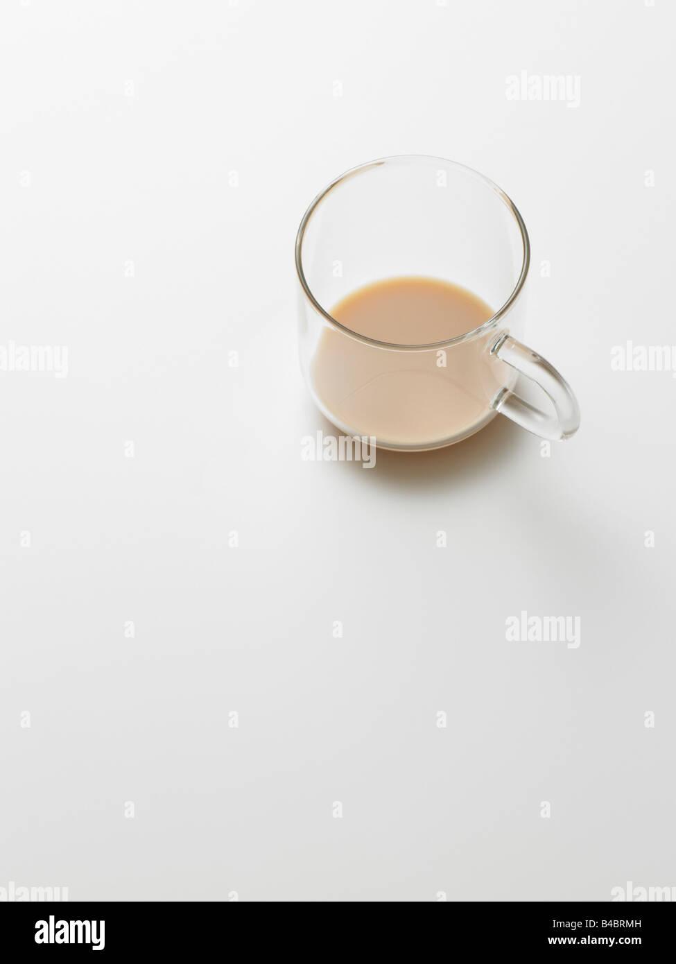 glass tea mug on plain background - Stock Image