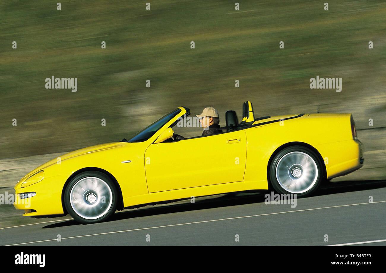 Car, Maserati Spyder, model year 2001-, yellow, driving ...