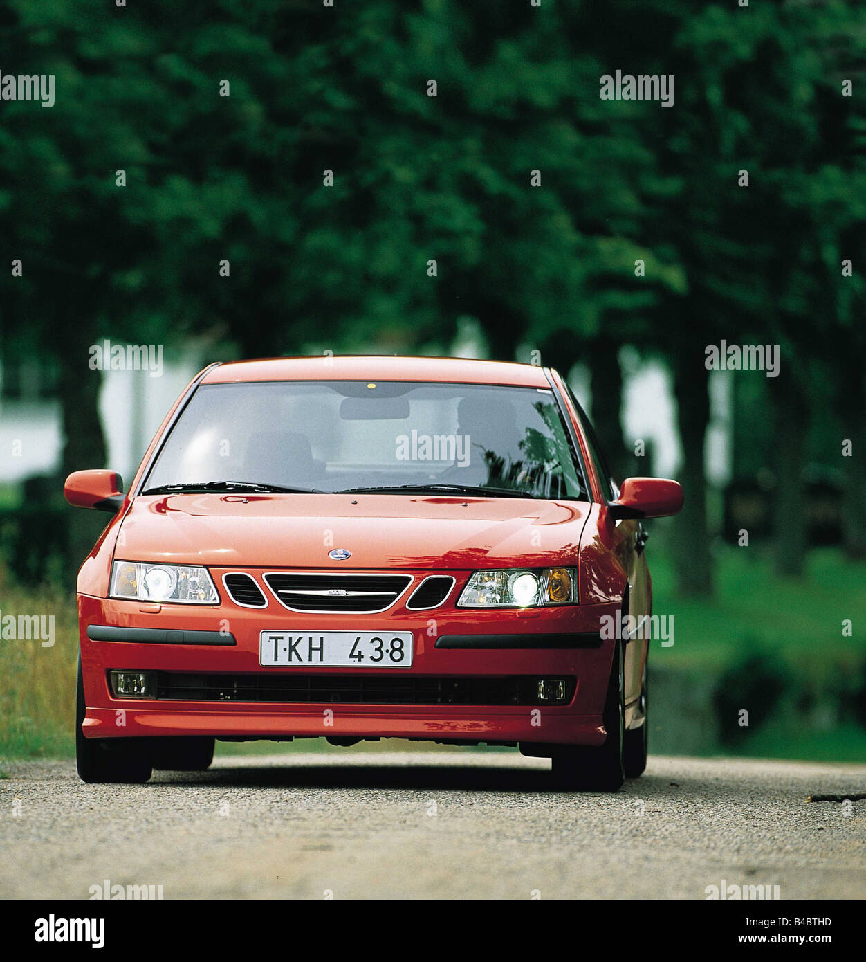Car, Saab 9-3, Limousine, medium class, red, from the front, frontal view, standing, upholding, model year 2002 - Stock Image
