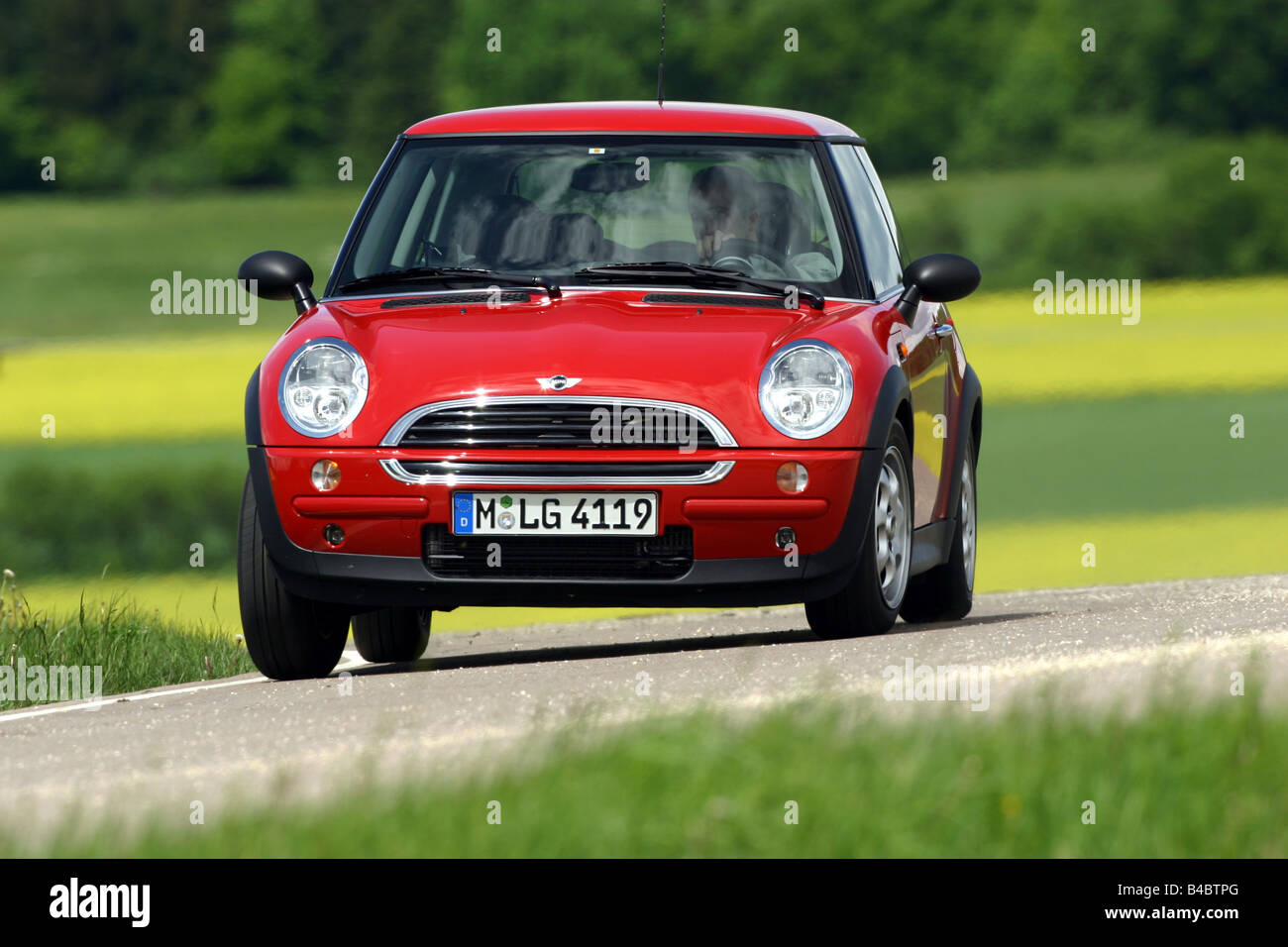 Car, Mini One D, Miniapprox.s, Limousine, model year 2001-, red, driving, diagonal from the front, frontal view, - Stock Image