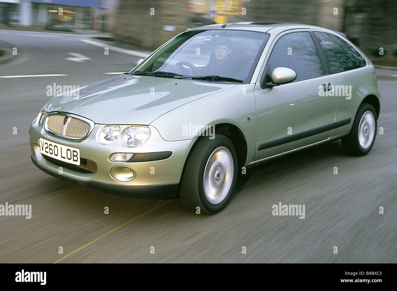 Car, Rover 25, model year 2000-, small approx., Limousine, diagonal from the front, green-metallic, driving, 100 - Stock Image