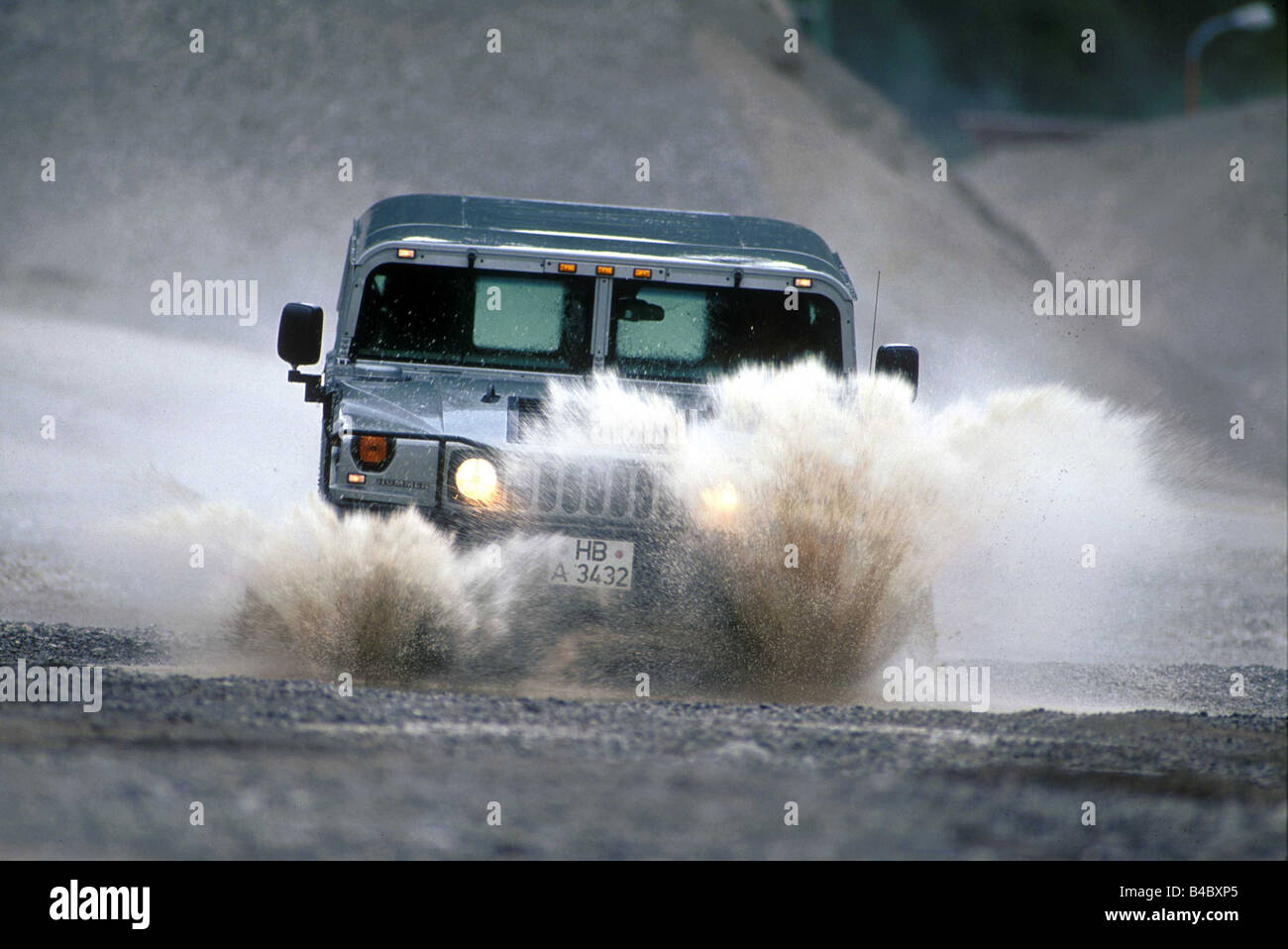 Car, Chevrolet Hummer 6.5L Impression, cross country vehicle, model year 1998-, gray, frontal view, driving, offroad, - Stock Image