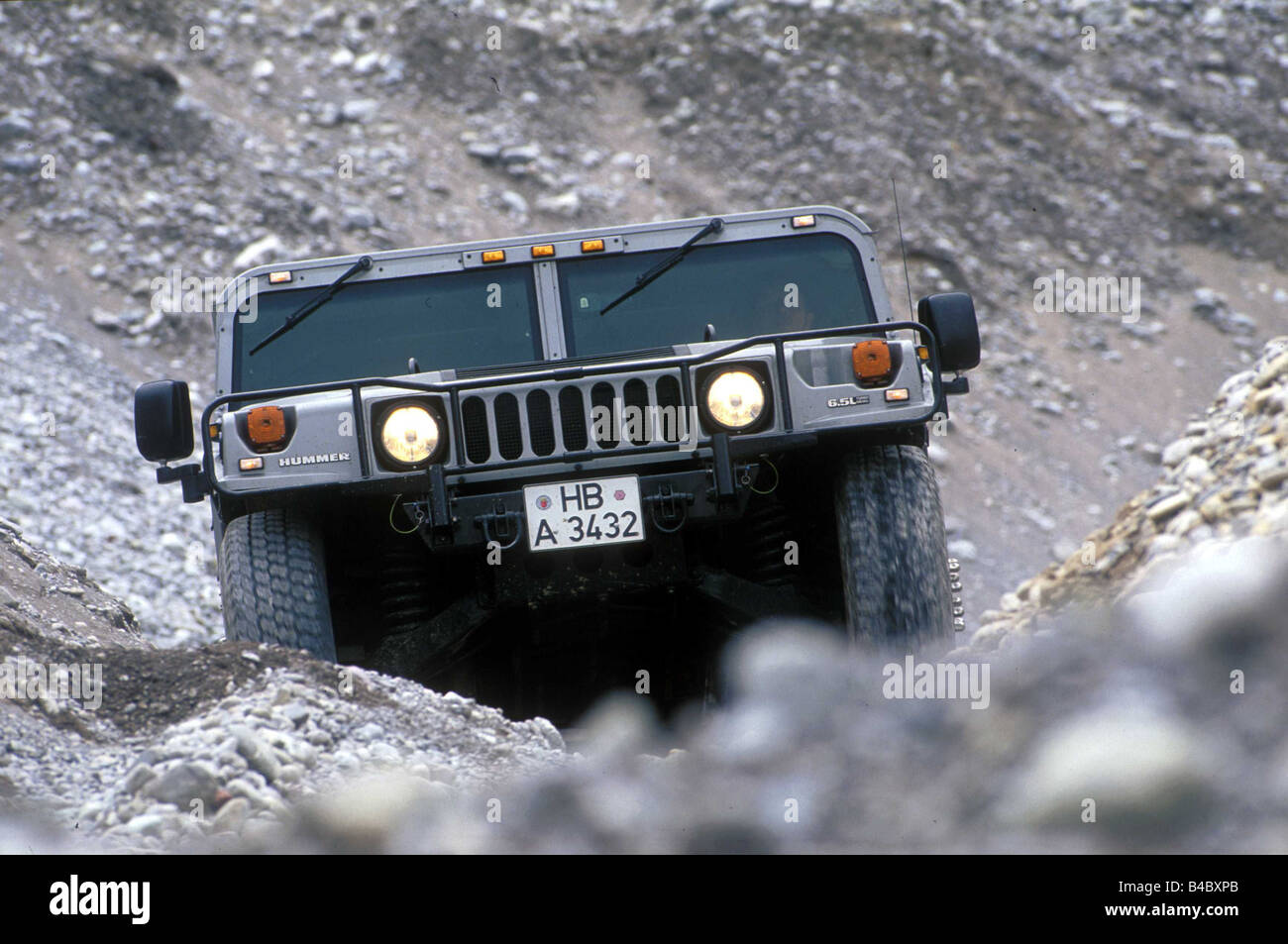 Car, Chevrolet Hummer 6.5L Impression, cross country vehicle, model year 1998-, gray, diagonal from the front, driving, - Stock Image