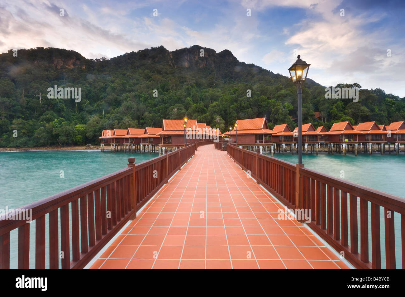 Asia, Malaysia, Langkawi Island, Pulau Langkawi, traditional style stilted houses and pier - Stock Image