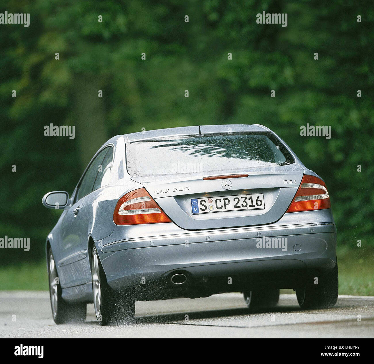 Car, Mercedes CLK 200 CGI, roadster, coupe, model year 2002-, silver, diagonal from the back, driving, country road, - Stock Image
