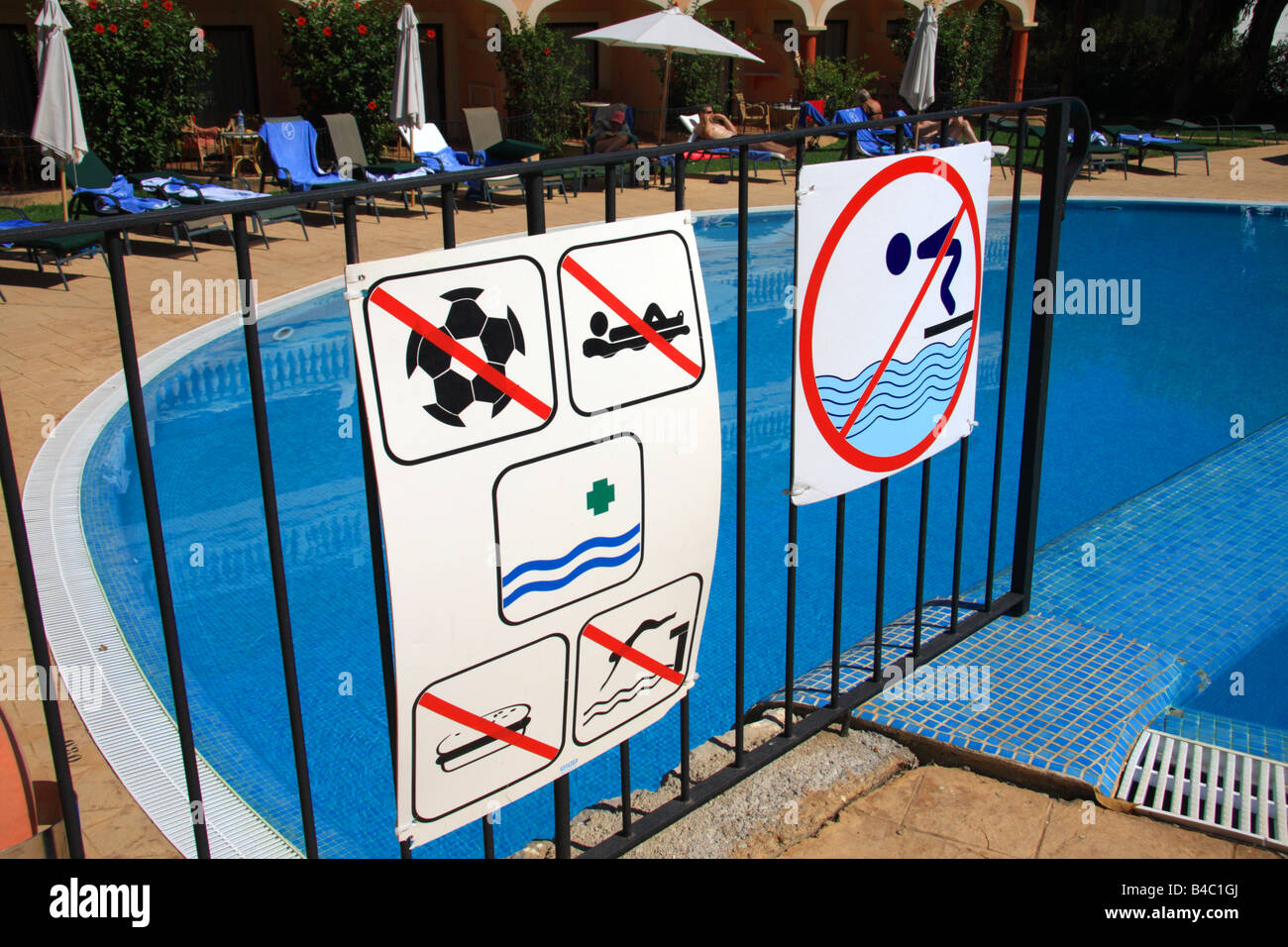 A group of safety signs in front of a swimming pool Stock ...