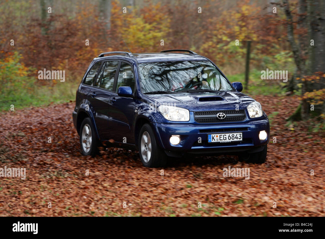 Car toyota rav4 d 4d cross country vehicle model year 2004 blue car toyota rav4 d 4d cross country vehicle model year 2004 blue moving diagonal from the front frontal view country road publicscrutiny Images
