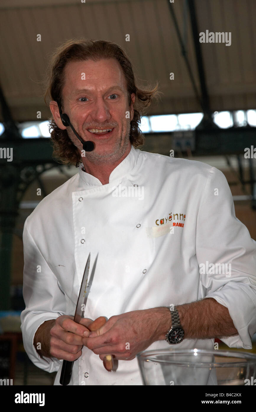Celebrity Chef Paul Rankin performs a cookery demonstration at St Georges Market Belfast Northern Ireland UK - Stock Image