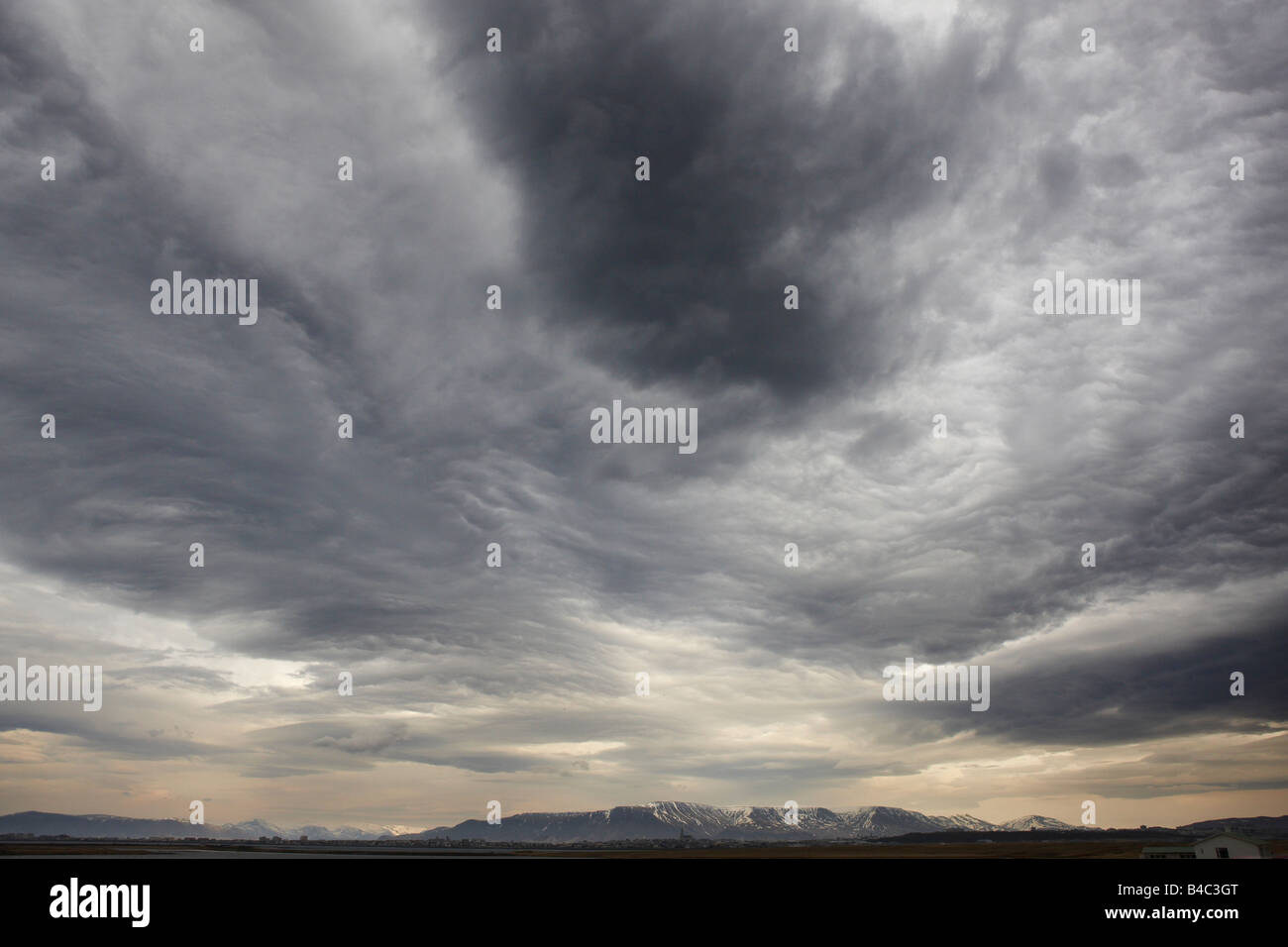 Overcast Sky with Mountains, Eastern Iceland - Stock Image