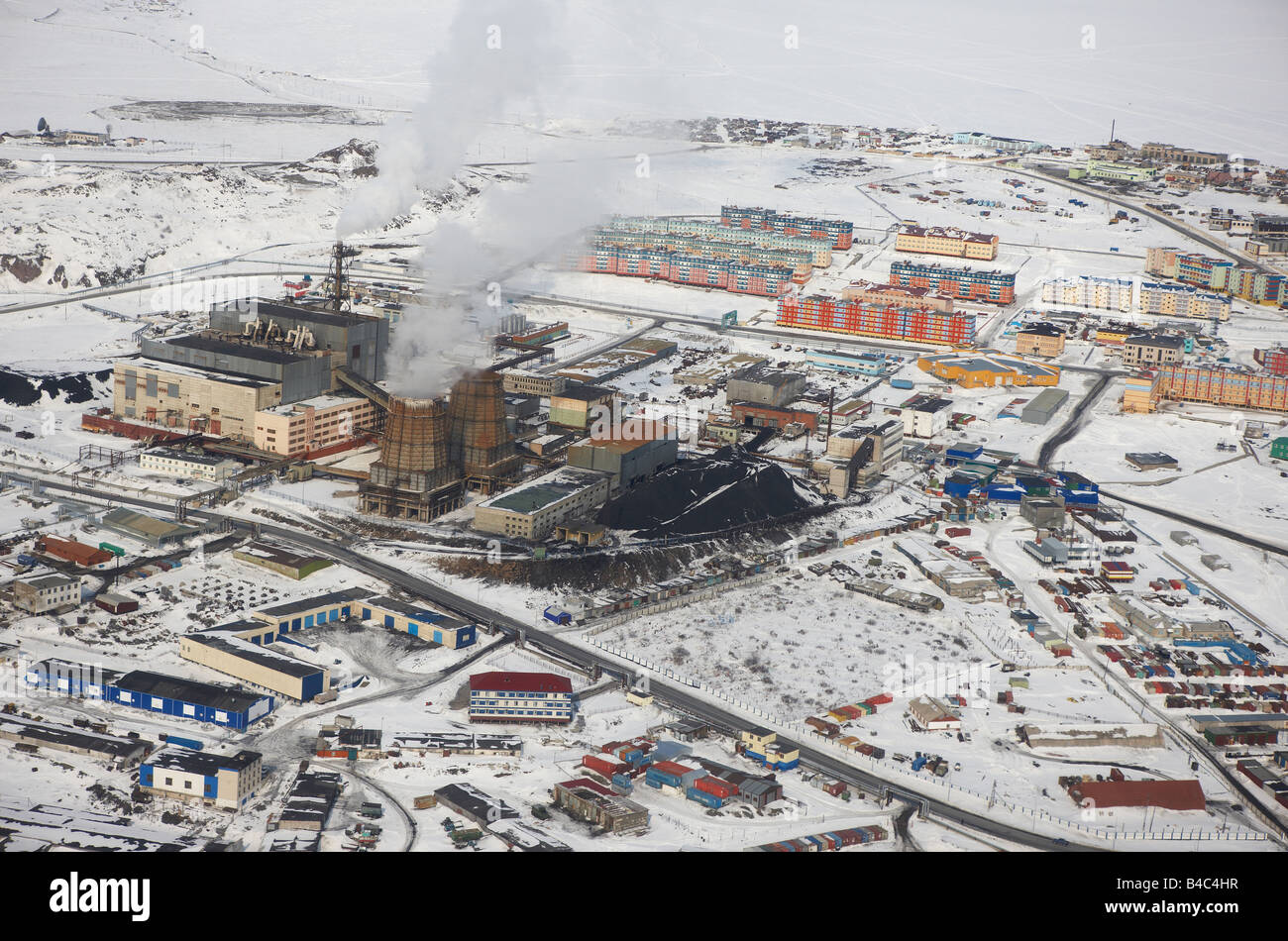 Coal powered polluting power station close to apartment buildings, Anadyr ,Chukotka Siberia, Russia - Stock Image