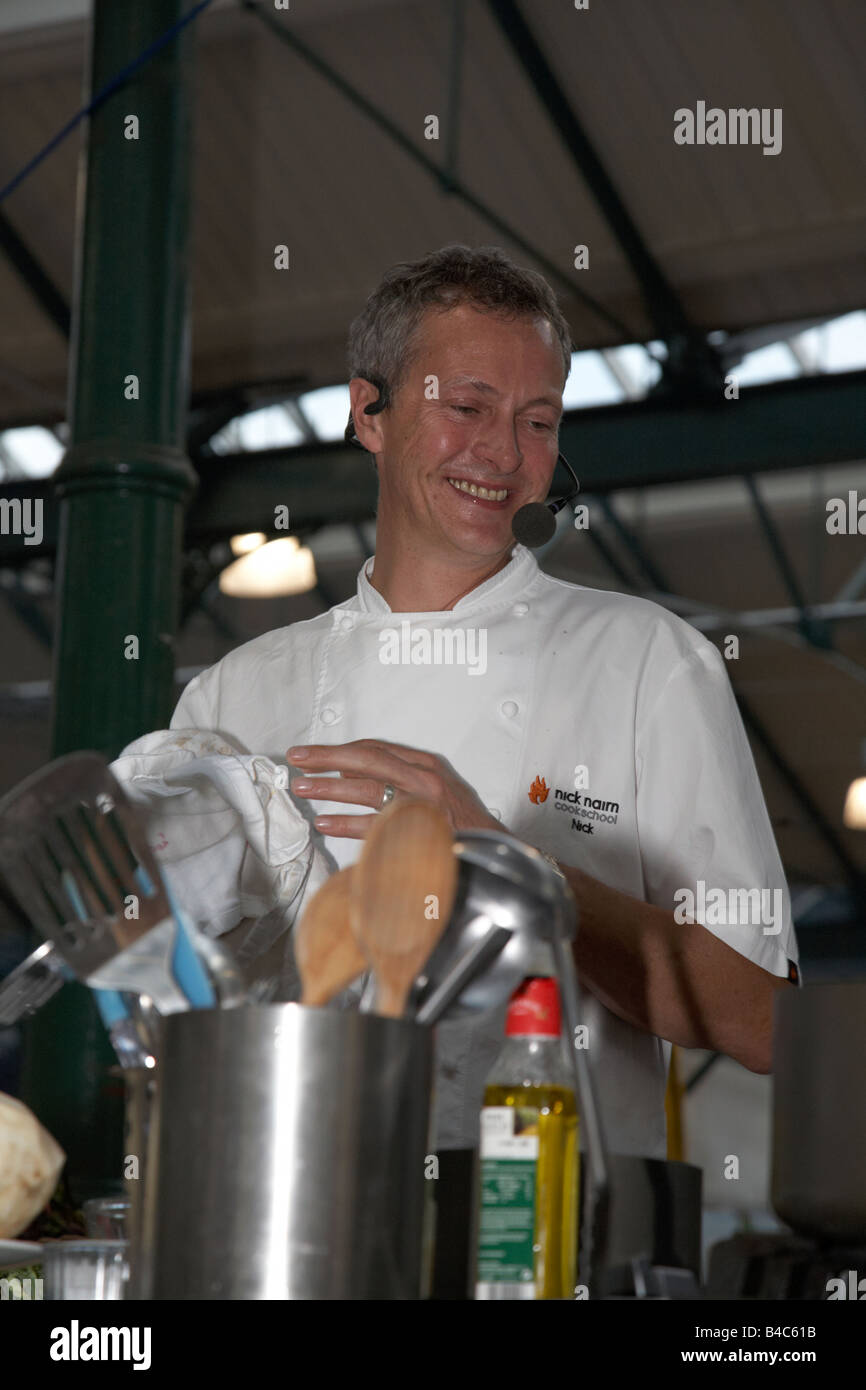Celebrity Chef Nick Nairn performs a cookery demonstration at St Georges Market Belfast Northern Ireland UK - Stock Image