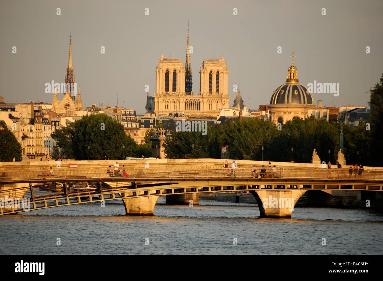 Seine bridge and the church Notre Dame de Paris in Paris France - Stock Image
