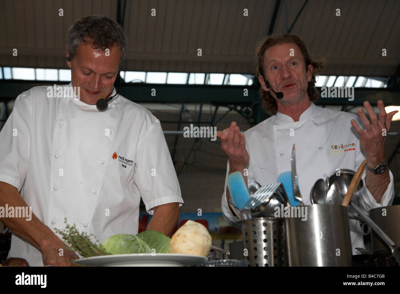Celebrity Chefs Nick Nairn and Paul Rankin perform a cookery demonstration at St Georges Market Belfast Northern - Stock Image