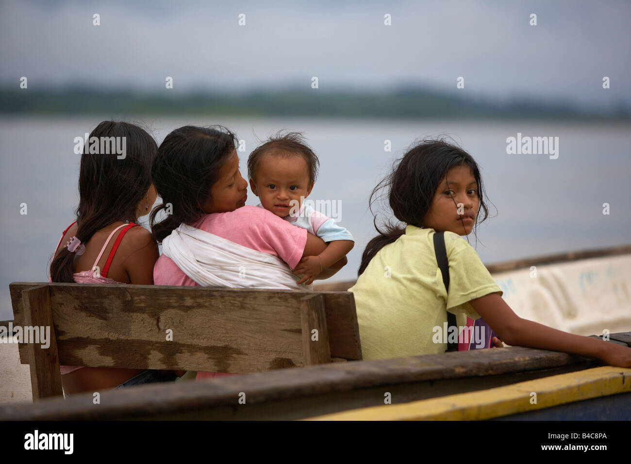 Girls  on water taxi, Napo River, Amazon Rain Forest, Ecuador - Stock Image