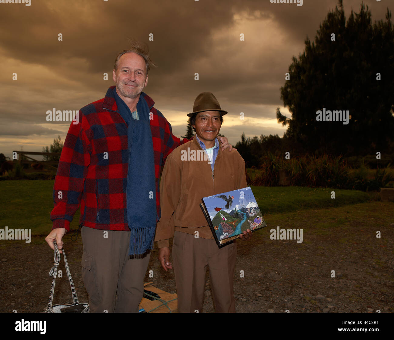 Tourist with local artist, Andes Mountains, Ecuador - Stock Image