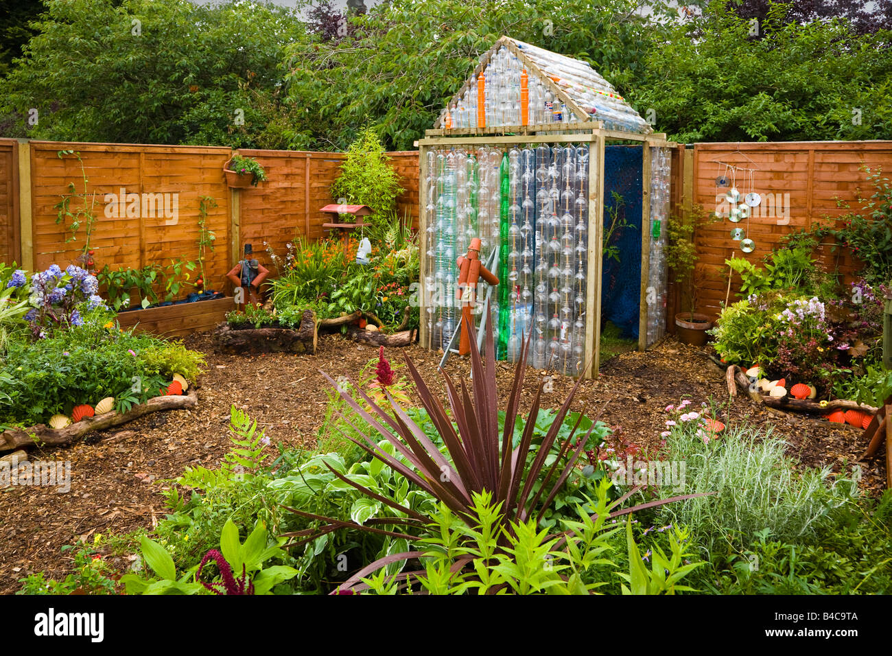 Ecology garden with greenhouse made from plastic bottles, Garden ...