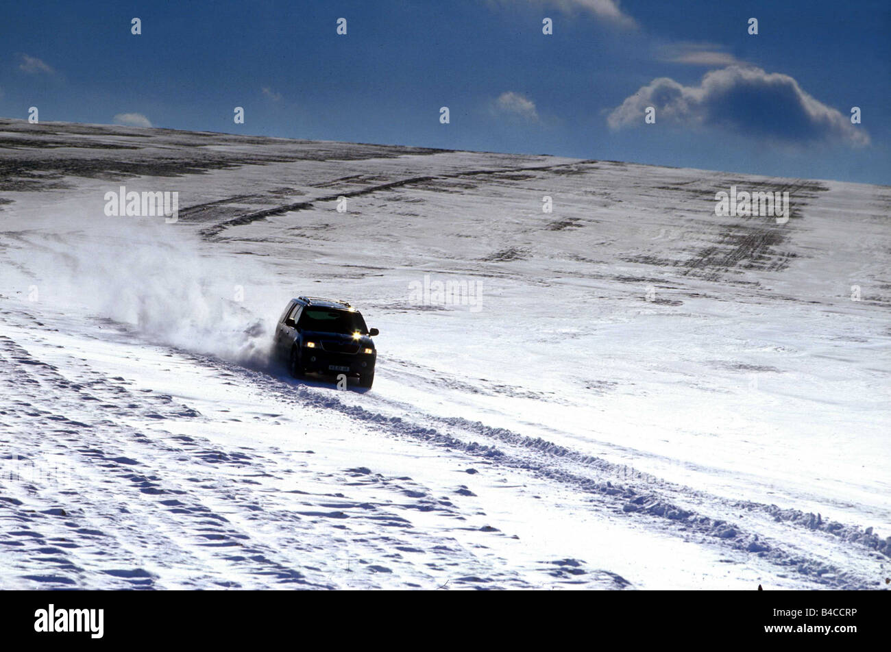 Car, Lincoln Navigator, cross country vehicle, model year 1999-, black, driving, Winter, Snow, snow-covered street, - Stock Image