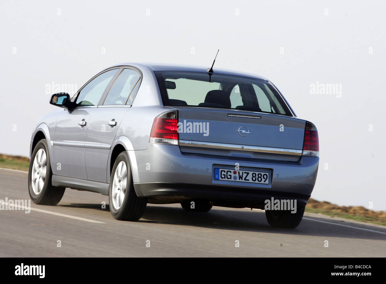 Car, Opel Vectra 2.2 direct, model year 2005-, silver, Limousine, medium class, driving, diagonal from the back, - Stock Image