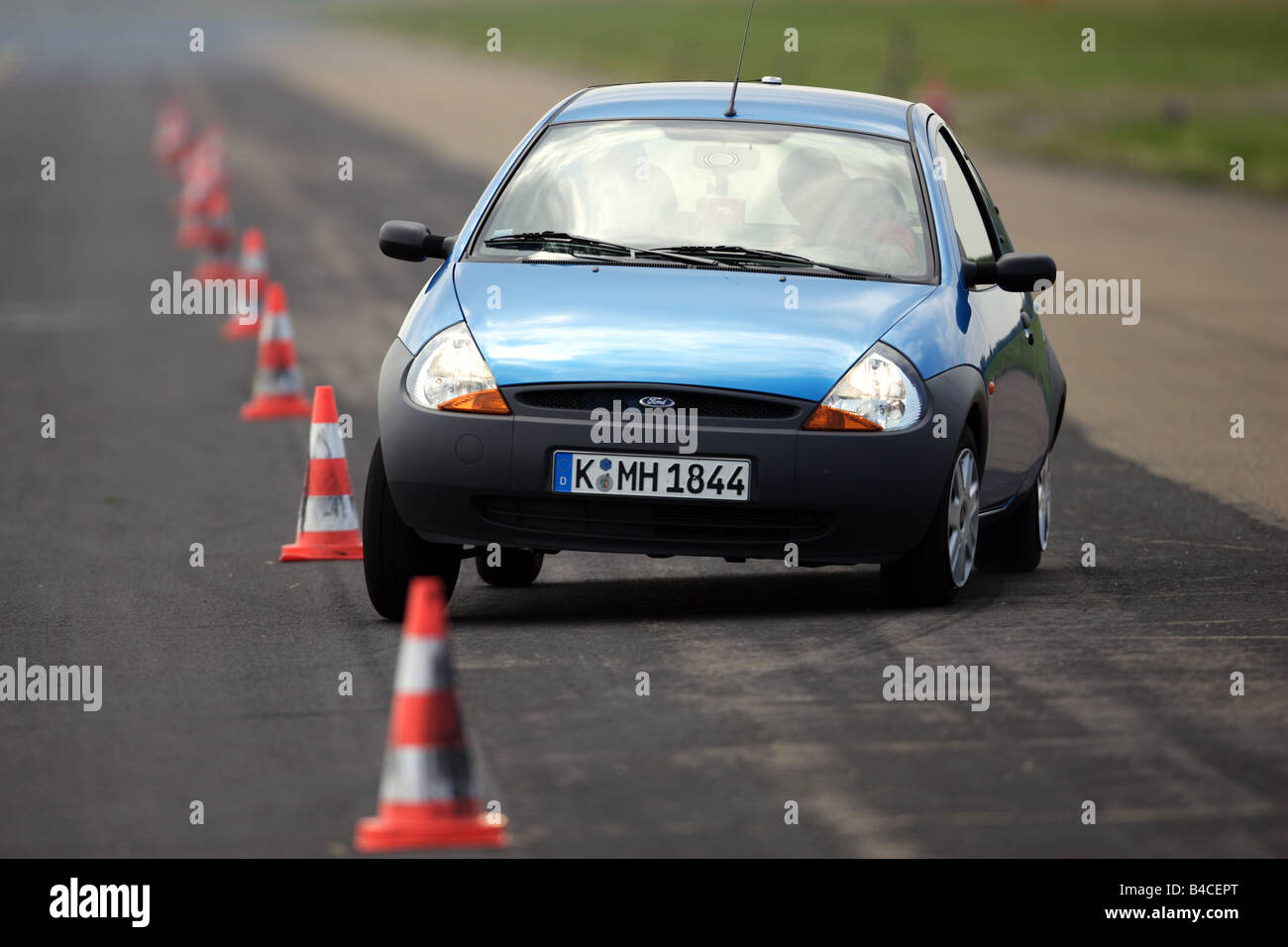 Car Ford Ka Student Blue Model Year  Driving Diagonal From The Front Frontal View Test Track Pilonen Photographer