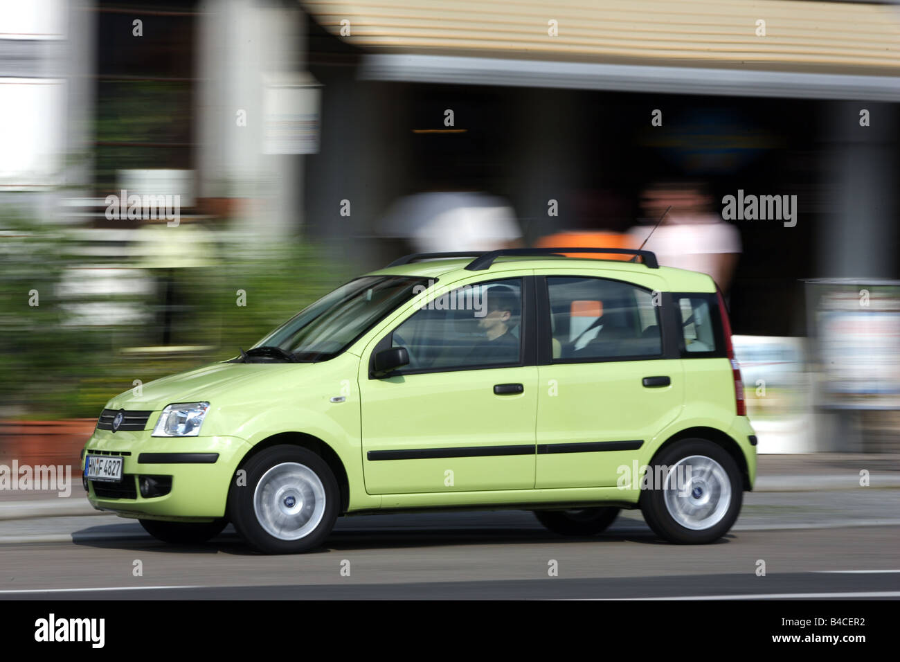 car-fiat-panda-1-2-light-green-model-year-2004-driving-diagonal-from-the-front-frontal-view-side-view-city-photographe
