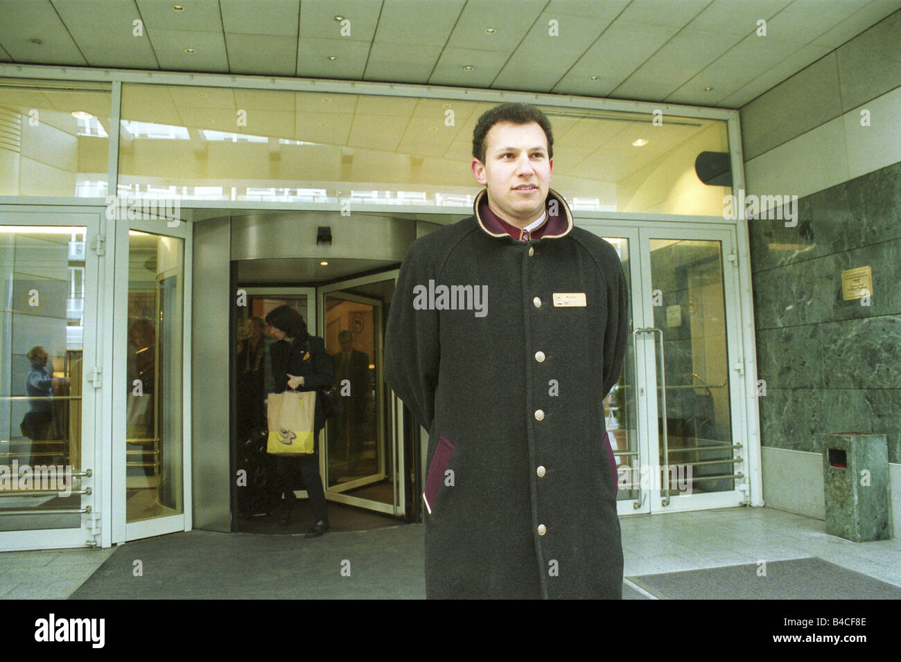 A doorman in front of the entrance to the Sheraton Hotel, Warsaw, Poland - Stock Image