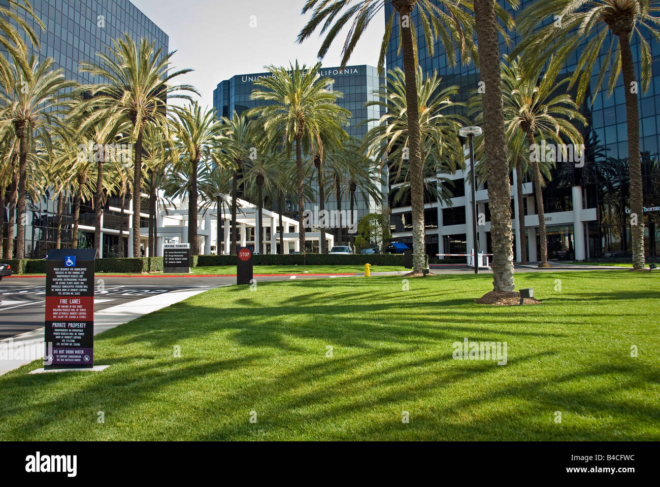 Irvine Towers Newport Beach California four granite and glass office tower building exteriors Landscaped grounds - Stock Image
