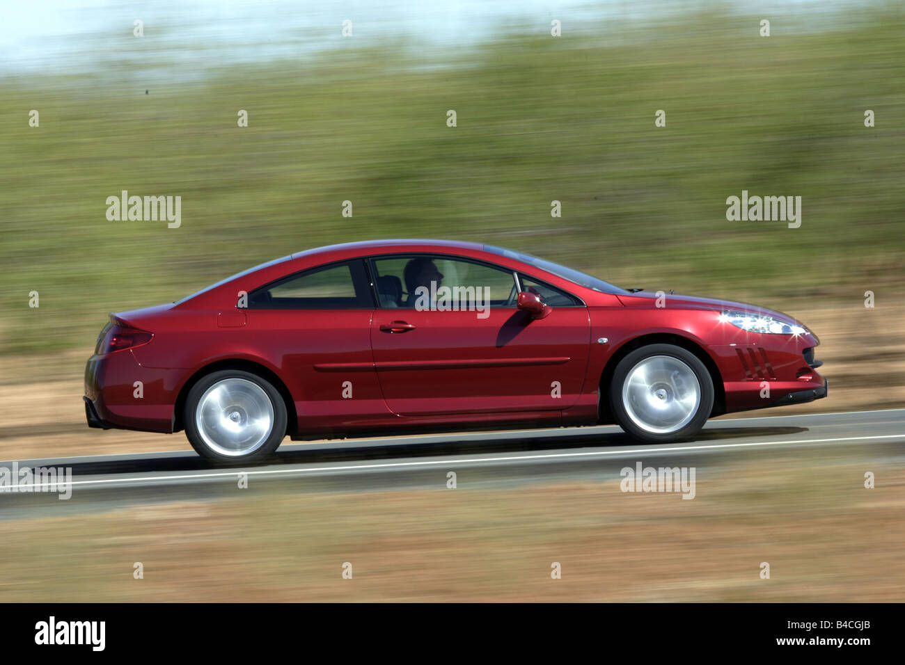 Peugeot 407 Coupe V6 210, model year 2005-, red, driving, side view, country road - Stock Image