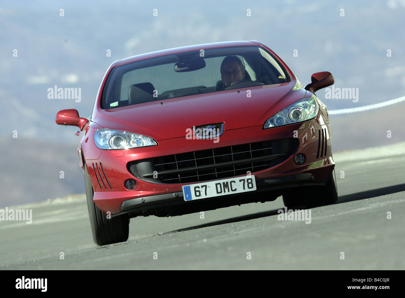 Peugeot 407 Coupe V6 210, model year 2005-, red, driving, frontal view, country road - Stock Image