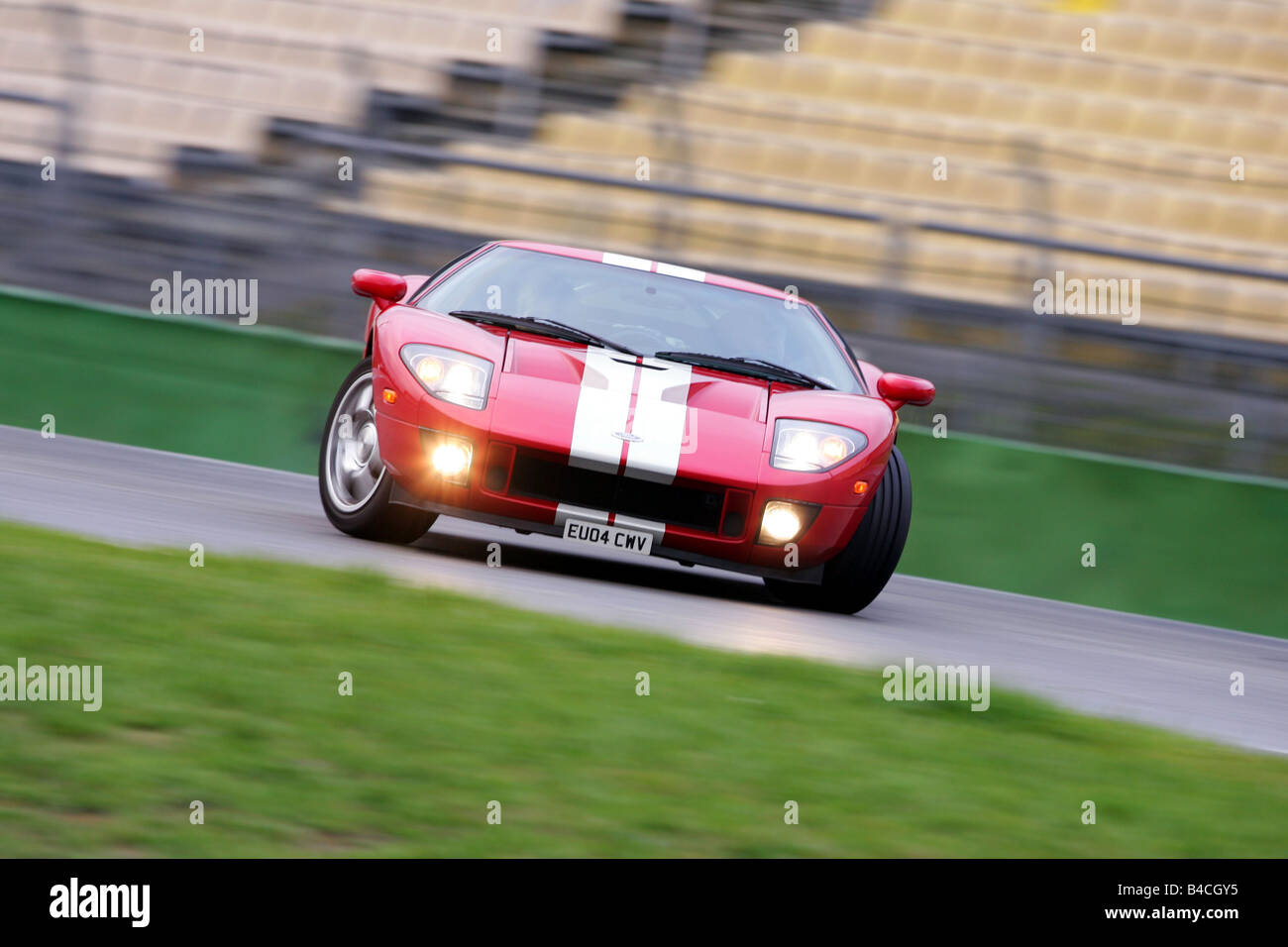 Ford Gt Model Year  White Red Driving Diagonal From The Front Frontal View Test Track Drift Drifting