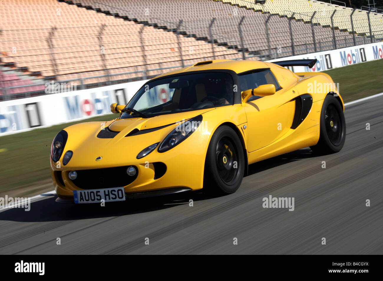 Lotus Exige 240R, model year 2005-, yellow, driving, diagonal from ...