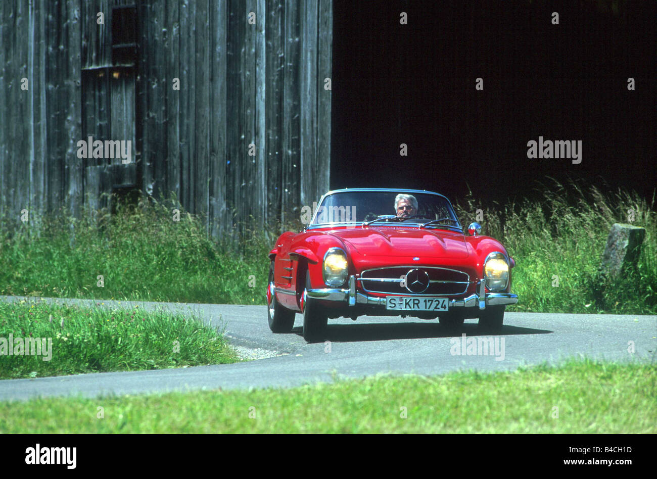 Car Mercedes 300 SL Roadster Convertible Model Year 1957 1963 Red Vintage Approx 1950s Sixties Open Top Driving Count