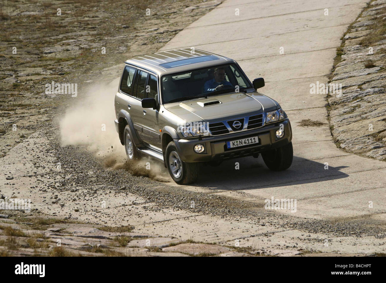 Car, Nissan Patrol, cross country vehicle, model year 1997-, silver-beige, fawn, driving, diagonal from the front, - Stock Image