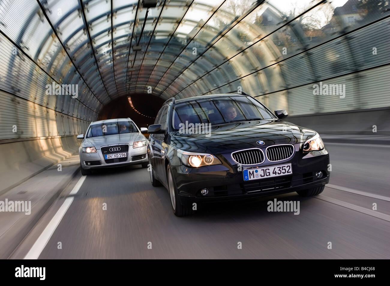 Bmw 550i Touring Black Followed By Audi A6 Avant 4 2 Quattro Stock Photo Alamy