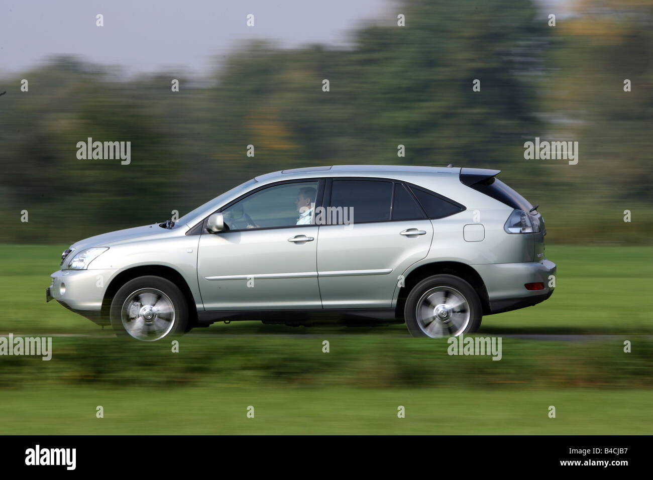 Lexus RX 400h, model year 2005-, silver, driving, side view, country ...