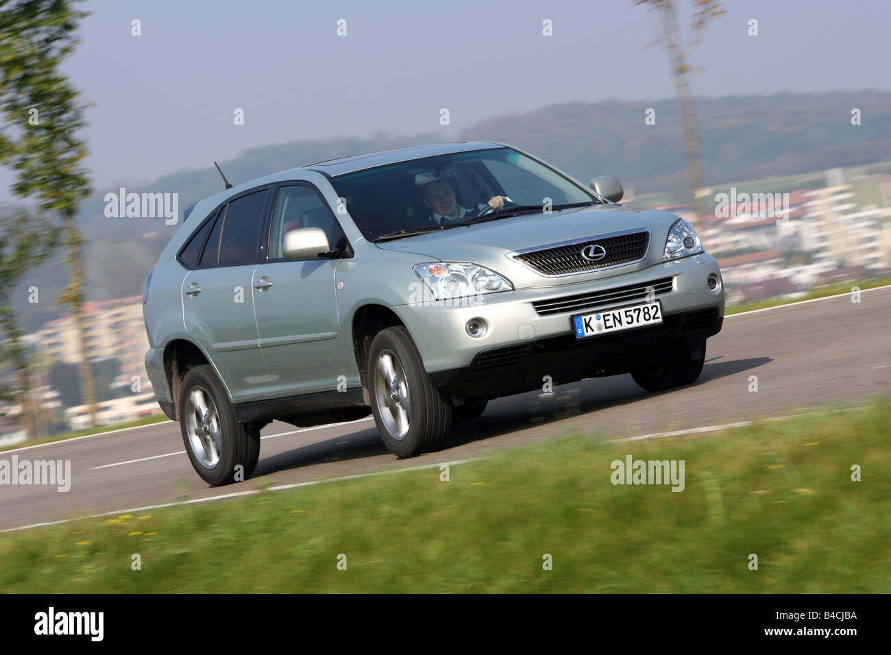 Lexus RX 400h, model year 2005-, silver, driving, diagonal from the ...
