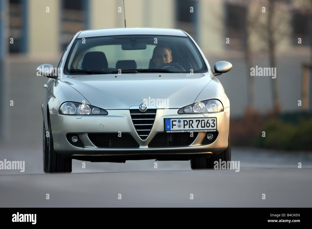 Alfa Romeo 147 1.9 JTD 16 V Distinctive, model year 2004-, silver, driving, frontal view, City - Stock Image