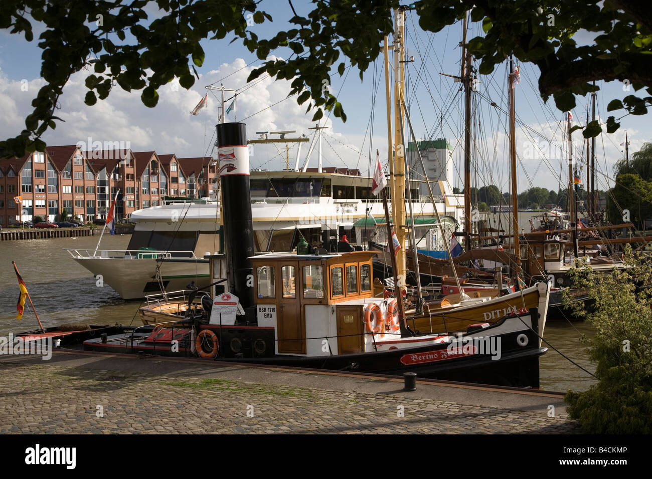 Boats moored on river at Leer Germany - Stock Image