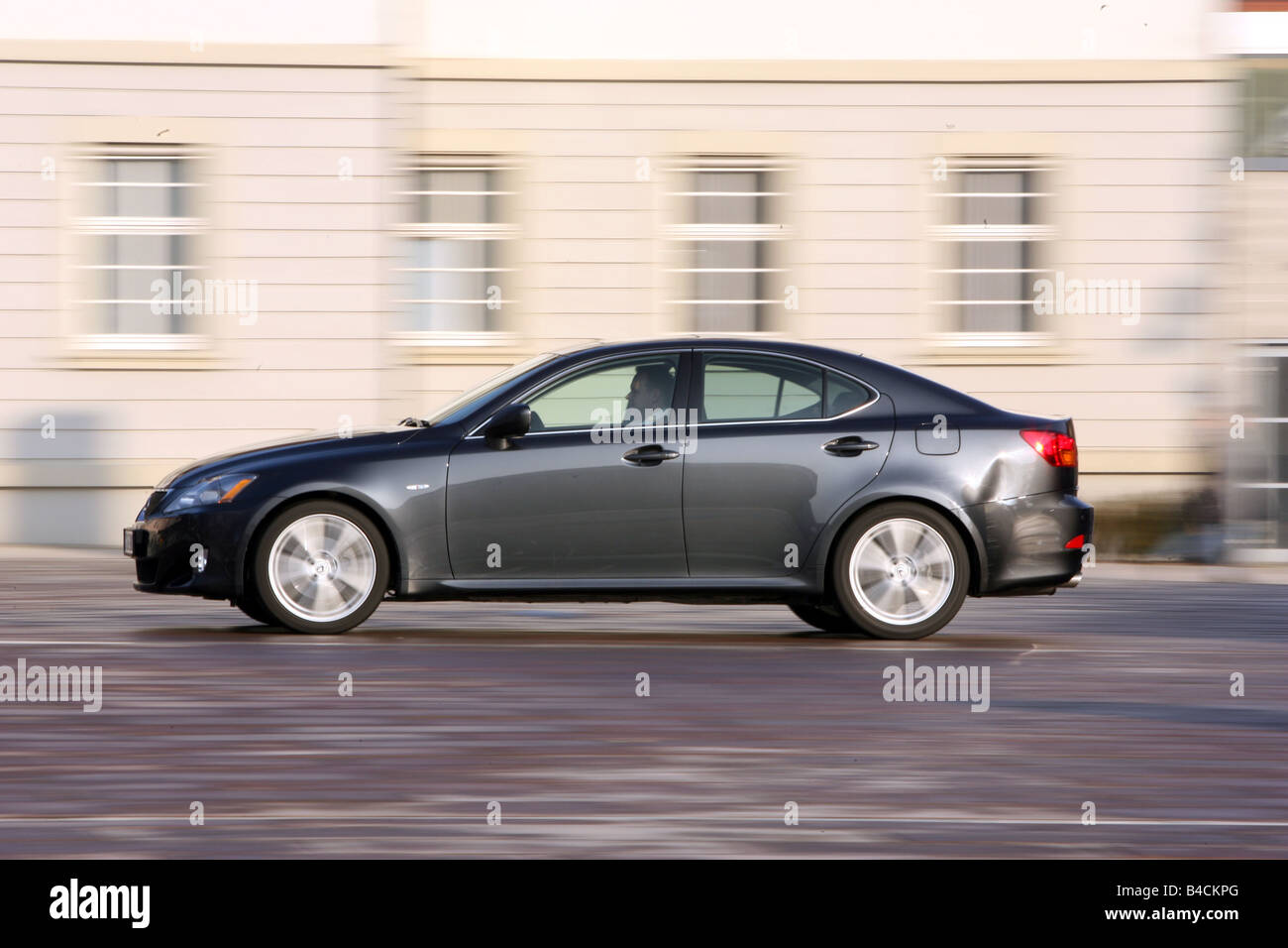 Lexus IS 250, model year 2005-, black, driving, side view, City - Stock Image