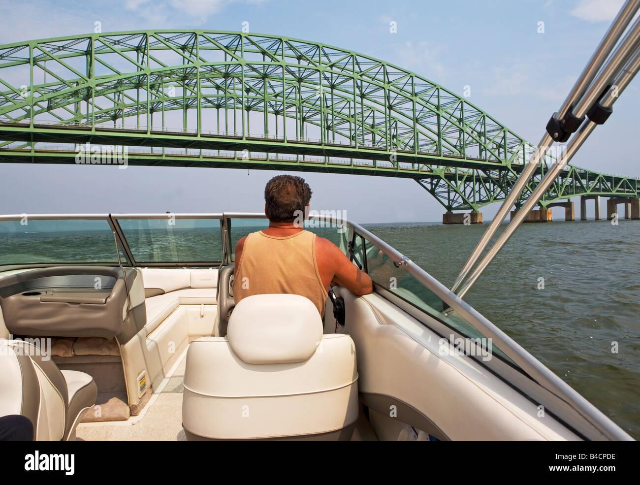 power, boat, motor, water, sport, cruising, recreation, fast, floating, driver, man, steering - Stock Image